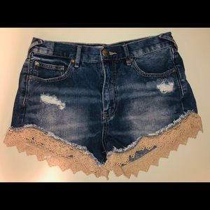 Distressed denim short with crochet trim